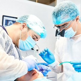 dentists conducting dental surgery