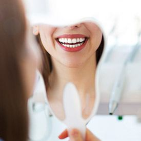 Patient looking at smile in mirror