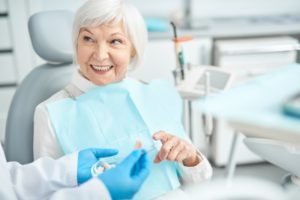 learning the difference between partial dentures and dental bridges